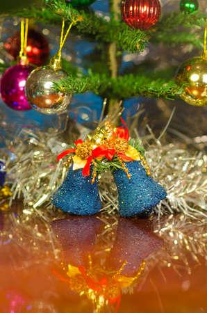 christmas bells near decorated tree Stock Photo - 24456881