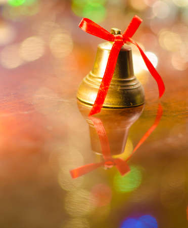 christmas bell near decorated tree photo