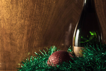 bottle of champagne on wooden background photo