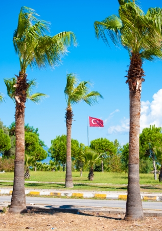 flag of Turkey in town of Side near ancient ruins photo