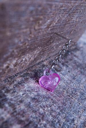 pink plastic heart on wood photo