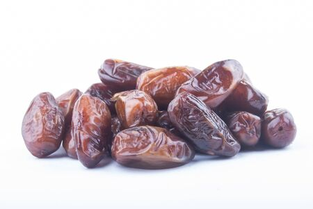 deglet: dried fruits from date palm isolated on white
