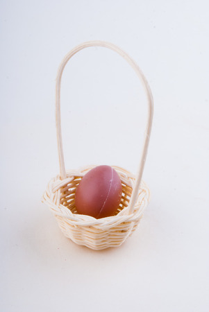 wooden egg in a basket photo