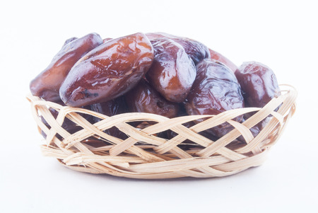 deglet: dried fruits from date palm in basket isolated on white Stock Photo