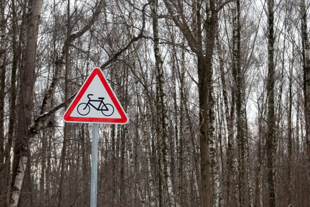 traffic sign near pathway in birch forest, winter landscape in russia photo
