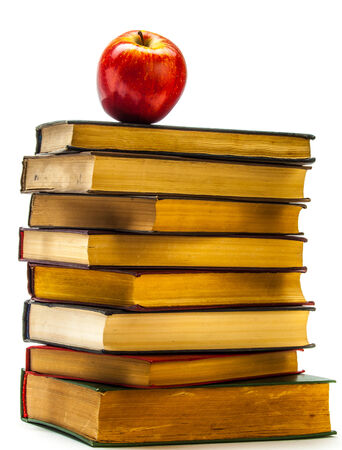 Stack of Old Books With an Apple on Top isolated on white
