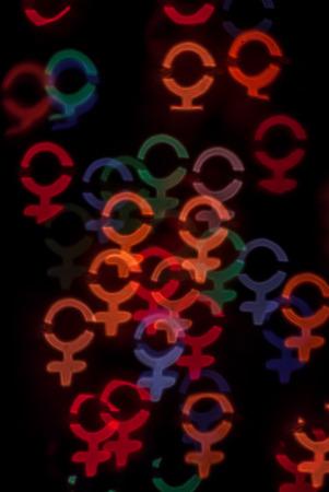 defocused photo with female gender symbols photo