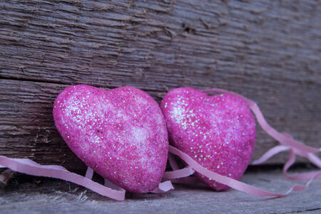 pink hearts on wood photo