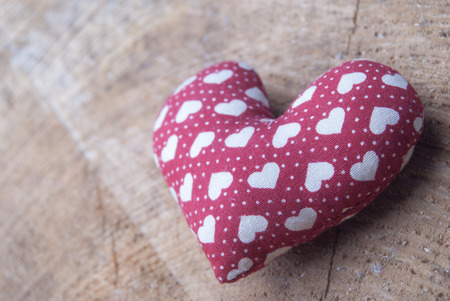 red heart on wood photo