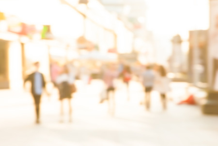 City commuters. High key blurred image of workers going back home after work. Unrecognizable faces, bleached effect. Stock Photo