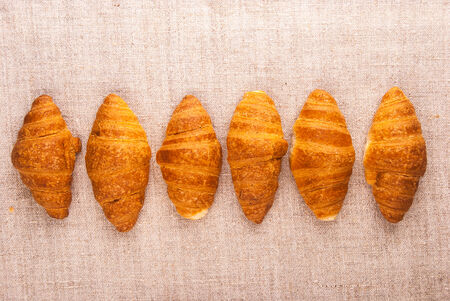 Croissants on rough fabric shot from above photo