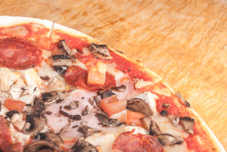 Pizza on cutting board on table photo