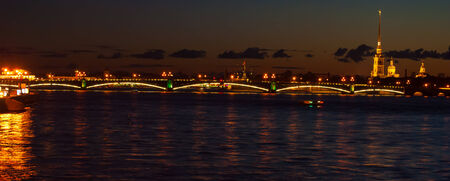 The Peter and Paul Fortress and Trinity Bridge across the Neva river, Saint Petersburg, Russia photo