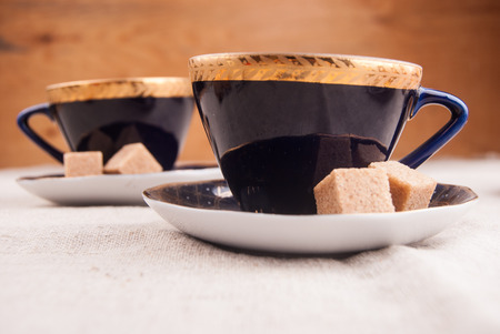 Blue china cup with brown sugar photo