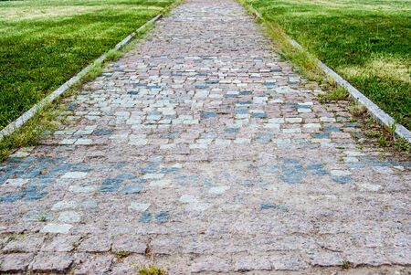 tiled pathway in green park, outdoors photo