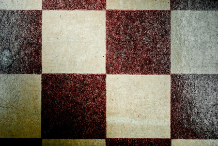 outworn: old grungy checkerboard Stock Photo
