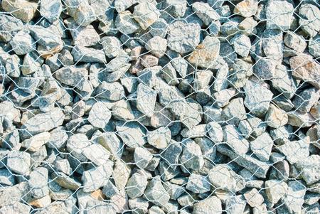 gabion: pebble stones in aluminiummesh