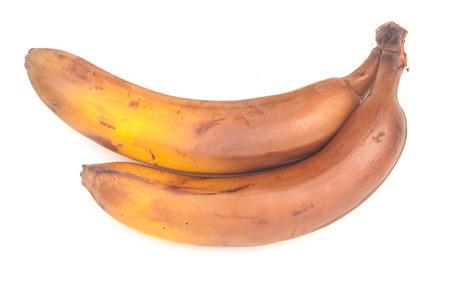 old banana on white photo