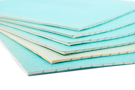 Stack of notebooks isolated on white photo
