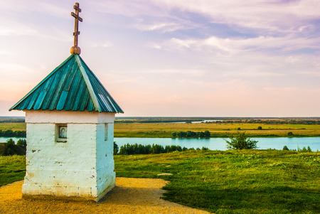 priesthood: Little chapel with beautiful landscape in Konstantinovo, Russia - the birthplace of russian poet Sergei Yesenin Stock Photo
