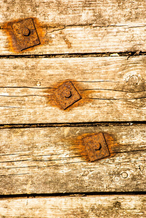splintered: Old Shabby Wooden Planks with rusted bolts, grungy texture
