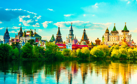 Beautiful landscape with Izmaylovo Kremlin behind river and lush greenery, Moscow, Russia