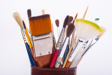 Brushes on the tin can isolated on a white background photo