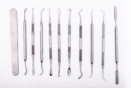 close up dental instruments on white background Reklamní fotografie