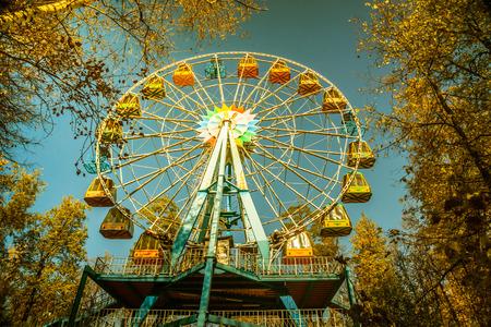 vintage photo of a ferris wheel in an autumn park