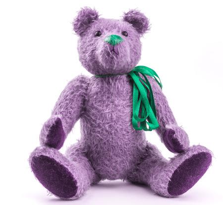 Purple Teddy Bear on white. Stock Photo