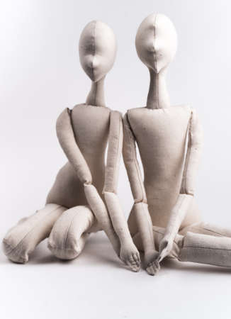 love image: Two handmade textile dolls sitting together. Image of love, affection.