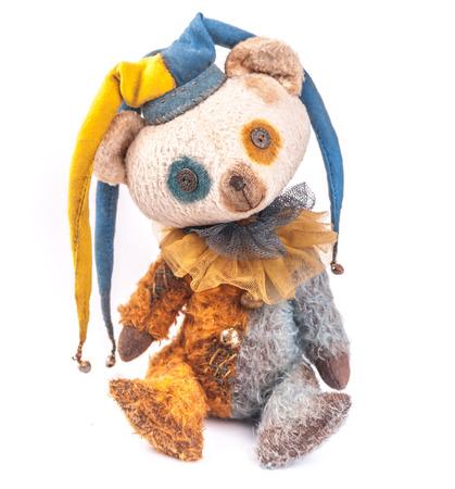 scary clown: Vintage Teddy Bear in clowns gown.