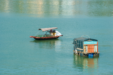 Boats in a fishing village near Ha Long bay, Vietnam photo