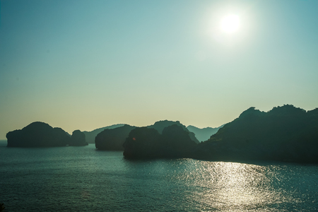 ba: Beautiful sunset in Ha Long Bay viewed from Cat Ba island, Vietnam