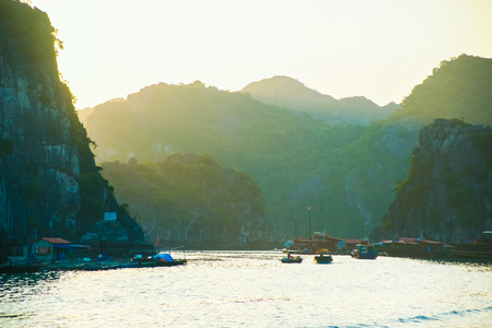 long bay: Ha Long Bay at sunset with lens flare effect Stock Photo