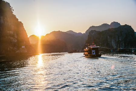 ba: Ha Long Bay at sunset with lens flare effect Stock Photo