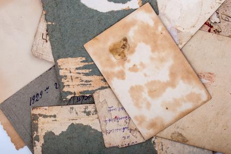 crinkled: Backs of old photographs. Aged paper background.
