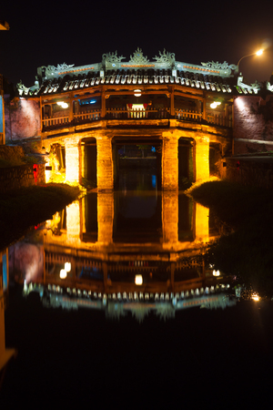 Old japanese bridge at night in Hoi An, Vietnam photo