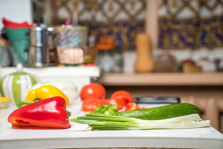 tea cosy: Cosy kitchen interior with fresh vegetables on table Stock Photo