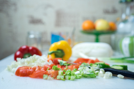 cosy: Cosy kitchen interior with fresh vegetables on table Stock Photo