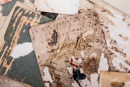 Backs of old photographs. Aged paper background.