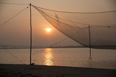 purple sunset: Calm scene of fishing net against purple sunset