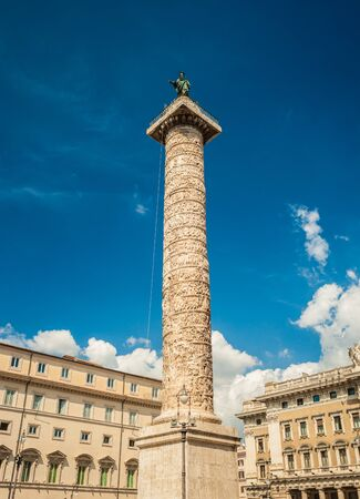 2nd century: Marble Column of Marcus Aurelius in Piazza Colonna square in Rome, Italy. It is a Doric column about 100 feet high built in 2nd century AD and featuring a spiral relief. Stock Photo