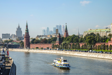 Kremlin battlement with a boat in the forefront in Moscow, Russia