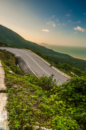 Hai Van pass - the famous road which leads along the coastline mountains near Da Nang city in Vietnam photo