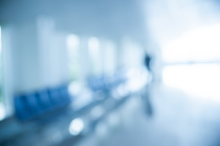 background photo: Blurred photo of an airport terminal. Blurred background for topics of Industrial architecture and transportation.