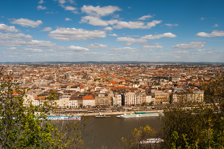 Cityscape of Budapest seen through greenery of the famous Gellert Hill. Beautiful travel background.