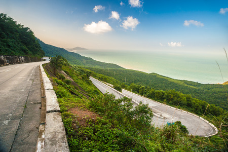 Hai Van pass - the famous road which leads along the coastline mountains near Da Nang city, Vietnam. Beautiful nature and transportation background. photo