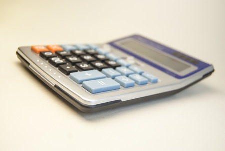 calculator isolated on whitem office object photo