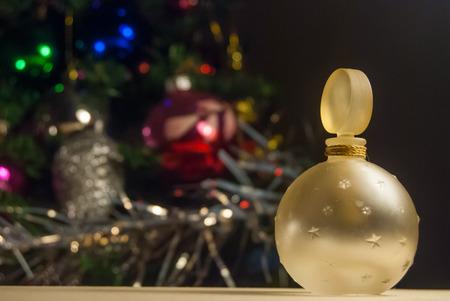 christmas perfume: christmas gifts under tree, perfume Stock Photo